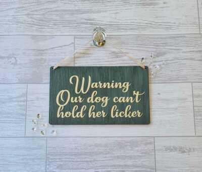 licker dog sign
